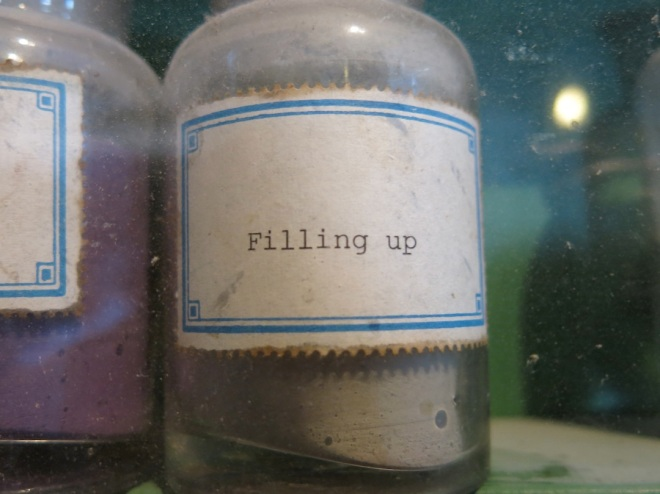 "Pigment from cabinet labeled ""Filling Up."""